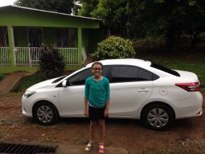My daughter smiling in the rain outside of La Chorrera this morning.